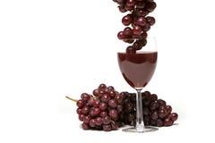 Uvas vermelhas e vinho Fotos de Stock Royalty Free