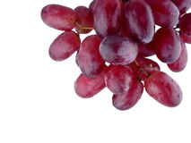 Uvas vermelhas no fundo branco Fotografia de Stock Royalty Free