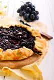 Uvas y tarta negras del romero Foto de archivo libre de regalías