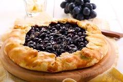 Uvas y tarta negras del romero Fotos de archivo