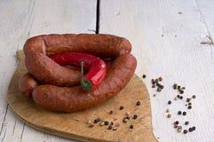 Kiełbasa, peppercorns i chili, Fotografia Royalty Free