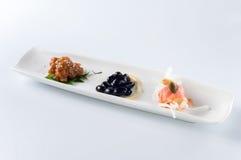 Uwędzony łososia i ślimaczka mięso, czarne fasole Obrazy Stock