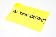 'In Uw Dromen!' geschreven op een kleverige nota Stock Fotografie