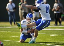 University of West Florida Football. UWF Kicker, Andrew Bogaenko 80, tries for the extra point as, Kaleb Nobles 6 holds the ball Royalty Free Stock Photo