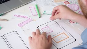 UX designer creating smartphone application layout stock video