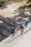 UXMAL, MEXICO - FEB 28, 2016: Tourists descend from the Grand Pyramid at the ruins of the ancient Mayan city Uxmal, Mexi. Co royalty free stock photo