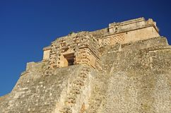 Uxmal pyramid top entrance. The top entrance to the great pyramid in Uxmal Mayan city, Mexico Stock Photo