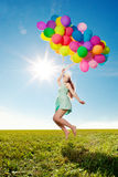 Uxury fashion stylish woman with balloons in hand on the field a royalty free stock images