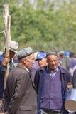 Uyghur人在喀什星期天家畜市场,中国上 免版税库存照片