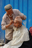Uyghur barber Stock Photo