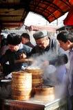 Uyghur Männer bei der Arbeit Kashgar Stockbild