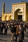 Uyghur men leaving Ramadan prayer service. Thousands of muslim worshipers depart Id Kah Mosque after service at the end of Ramadan. Kashgar, Xinjiang province
