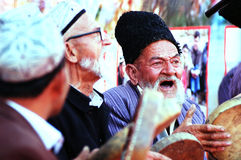 Uyghur old men singing with drums Stock Image