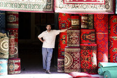The Uyghur  people. Stands in front of his cloth shop.Photo taken in Xinjiang of China,May 22rd,2011 Stock Photo