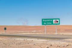 Uyuni, Bolivia. Border sign of ` Republica de Chile ` on desert crossing road on way to Bolivia through Atacama desert mountains Stock Photos