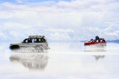 Uyuni Bolivia Driving on wet saltflats Royalty Free Stock Images