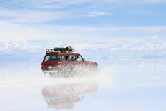 Uyuni Bolivia Driving on wet saltflats Stock Photos