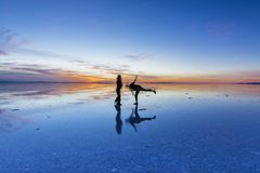 Uyuni reflections are one of the most amazing things that a photographer can see. Here we can see how the sunrise over an infinite royalty free stock photography