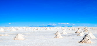 Uyuni Salt desert, Bolivia. Piles of salt to dry in Salar de Uyuni Royalty Free Stock Images