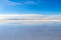 Uyuni Salt Flats in Bolivia, the incredible mirror-like lake in South America. Perfect reflection in Salar de Uyuni, Uyuni Salt Flats in Bolivia, the incredible royalty free stock images