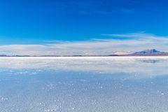 Uyuni Salt Flats in Bolivia, the incredible mirror-like lake in South America. Perfect reflection in Salar de Uyuni, Uyuni Salt Flats in Bolivia, the incredible stock photo