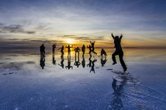Uyuni reflections are one of the most amazing things that a photographer can see. Here we can see how the sunrise over an infinite stock photos