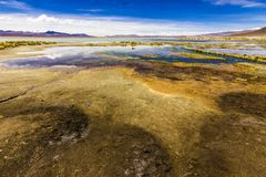 On the way to Uyuni the amazing White Lagoon offer us incredible reflections and views over the Andes volcanos surrounding the lag royalty free stock image