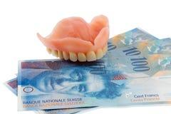 Uzębienie i szwajcarski frank zdjęcie royalty free