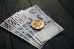 Uzbek banknotes and Bitcoin. Fifty Thousand Uzbek Sums. Uzbek banknotes and and Bitcoin on wooden background. Currency. Uzbek Money. Fifty Thousand Uzbek Sums Stock Photos