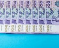 Uzbek banknotes. Fifty Thousand Uzbek Sums. Uzbek banknotes on blue background. Currency. Uzbek Money. Fifty Thousand Uzbek Sums 50000 Royalty Free Stock Images