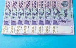 Uzbek banknotes. Fifty Thousand Uzbek Sums. Uzbek banknotes on blue background. Currency. Uzbek Money. Fifty Thousand Uzbek Sums 50000 Stock Images