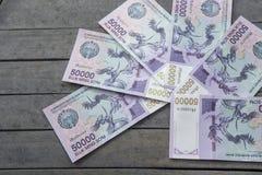 Uzbek banknotes. Fifty Thousand Uzbek Sums. Uzbek banknotes on wooden background. Currency. Uzbek Money. Fifty Thousand Uzbek Sums 50000 Stock Image