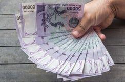 Uzbek banknotes. Fifty Thousand Uzbek Sums. Uzbek banknotes on wooden background. Currency. Uzbek Money. Fifty Thousand Uzbek Sums 50000 Royalty Free Stock Photos