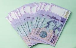 Uzbek banknotes. Fifty Thousand Uzbek Sums. Uzbek banknotes on light green background. Currency. Uzbek Money. Fifty Thousand Uzbek Sums 50000 Royalty Free Stock Image