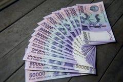Uzbek banknotes. Fifty Thousand Uzbek Sums. Uzbek banknotes on wooden background. Currency. Uzbek Money. Fifty Thousand Uzbek Sums 50000 Stock Images