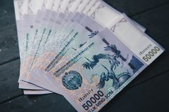 Uzbek banknotes. Fifty Thousand Uzbek Sums. Uzbek banknotes on wooden background. Currency. Uzbek Money. Fifty Thousand Uzbek Sums 50000 Stock Photos