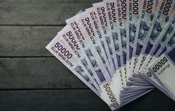 Uzbek banknotes. Fifty Thousand Uzbek Sums. Uzbek banknotes on wooden background. Currency. Uzbek Money. Fifty Thousand Uzbek Sums 50000 Royalty Free Stock Photo