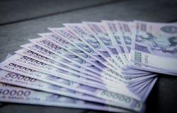 Uzbek banknotes. Fifty Thousand Uzbek Sums. Uzbek banknotes on wooden background. Currency. Uzbek Money. Fifty Thousand Uzbek Sums 50000 Royalty Free Stock Photography