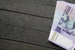 Uzbek banknotes. Fifty Thousand Uzbek Sums. Uzbek banknotes on wooden background. Currency. Uzbek Money. Fifty Thousand Uzbek Sums 50000 Royalty Free Stock Images