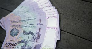 Uzbek banknotes. Fifty Thousand Uzbek Sums. Uzbek banknotes on wooden background. Currency. Uzbek Money. Fifty Thousand Uzbek Sums 50000 Royalty Free Stock Image