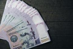 Uzbek banknotes. Fifty Thousand Uzbek Sums. Uzbek banknotes on wooden background. Currency. Uzbek Money. Fifty Thousand Uzbek Sums 50000 Stock Photo