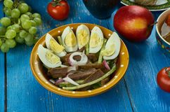 Uzbek beef salad. Tashkent, Traditional assorted dishes, Top view. Central Asian cuisine Royalty Free Stock Photos