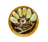 Uzbek beef salad. Tashkent, Traditional assorted dishes, Top view. Central Asian cuisine Royalty Free Stock Images