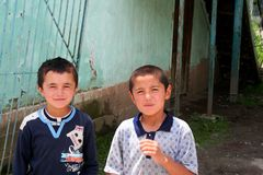 Uzbek Boys in Arslanbob, Kyrgyzstan Royalty Free Stock Photo