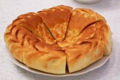 Uzbek bread. On plate (flat cake Royalty Free Stock Images