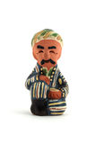 Uzbek Ceramic Figurine. Isolated photo of traditional Uzbek ceramic figurine of a man holding a tea cup Royalty Free Stock Photography
