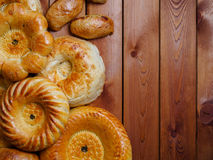 Uzbek national bread on wooden table on dark background Royalty Free Stock Images