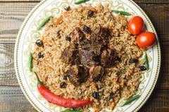Uzbek national dish pilaf with meat. Horizontal frame Stock Images