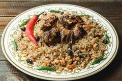 Uzbek national dish pilaf with meat. Horizontal frame Stock Image