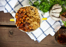 Uzbek national dish plov in a bowl Stock Photography